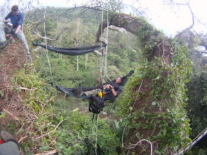 Man relaxing in his hammock high in the jungle canopy  in Guyana