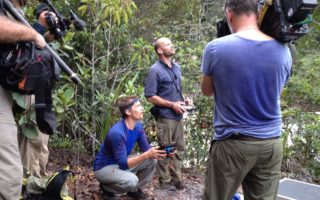 an image of men using camera equipment whilst filming in the Guyanan jungle
