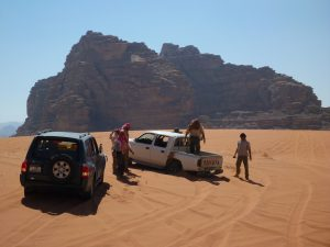an image of men and a group of 4x4s on the desert venture trip