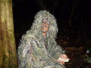 an image of a man wearing a net over his head on a Bushmasters Jungle Combat course