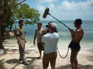 Film crew working on paradise island