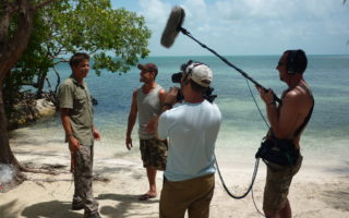 an image of a film crew working on paradise island