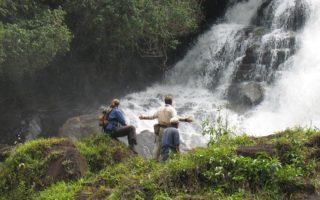 an image of three people looking at the waterfalls in Jordan