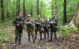 an image of a group of men standing in the jungle on a Bushmasters jungle combat venture