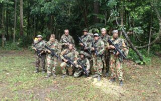 an image of a group of men dressed in camouflage ready for jungle combat