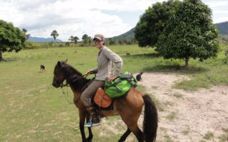 an image of a woman on a horse whilst taking part in a Bushmasters Ranch venture course