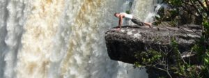 an image of a man doing press-ups at Guyana's sizeable waterfall during a Bushmasters expedition