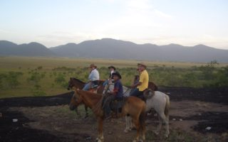 An image of several people sat on horses during a Bushmasters ranch trip