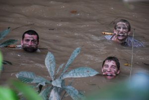 An image of three mean bobbing in a Guyanan river